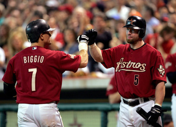 HOUSTON - OCTOBER 10:  Craig Biggio #7 of the Houston Astros is congratulated by Jeff Bagwell #5 after hitting a home run against the Atlanta Braves during the second inning of game four of the National League Divisional Series on October 10, 2004 at Minu