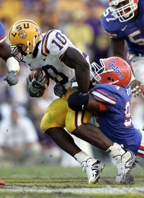 BATON ROUGE, LA - OCTOBER 15:  Joseph Addai #10 of Louisiana State University is tackled by Jarvis Moss #94 of the University of Florida  at Tiger Stadium in Baton Rouge, Louisiana on October 15, 2005. LSU defeated the University of Florida 21-17.   (Phot