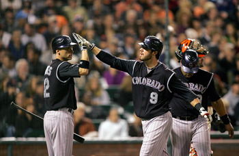 SAN FRANCISCO - SEPTEMBER 16:  Ian Stewart #9 of the Colorado Rockies is congratulated by Clint Barmes #12 after he hit a two-run home run to give the Rockies a 4-0 lead over the San Francisco Giants in the sixth inning of their game at AT&amp;T Park on Septe