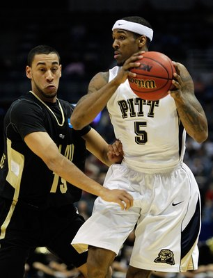 MILWAUKEE - MARCH 19:  Gilbert Brown #5 of the Pittsburgh Panthers with the ball against Drew Valentine #15 of the Oakland Golden Grizzlies during the first round of the 2010 NCAA men's basketball tournament at the Bradley Center on March 19, 2010 in Milw