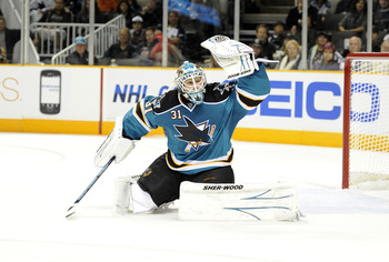 SAN JOSE, CA - OCTOBER 16: Goalie Antti Niemi #31 of the San Jose Sharks glove save a shot against the Atlanta Thrashers from going into the goal at the HP Pavilion October 16, 2010 in San Jose, California. (Photo by Thearon W. Henderson/Getty Images)