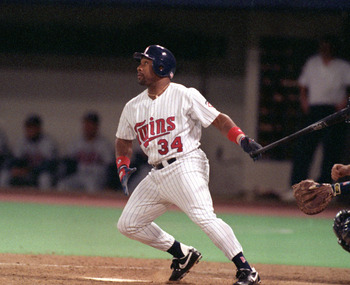 MINNEAPOLIS - OCTOBER 19:  Kirby Puckett #34 of the Minnesota Twins swings at a pitch during Game one of the 1991 World Series against the Atlanta Braves at the Metrodome on October 19, 1991 in Minneapolis, Minnesota. The Twins defeated the Braves 5-2.  (