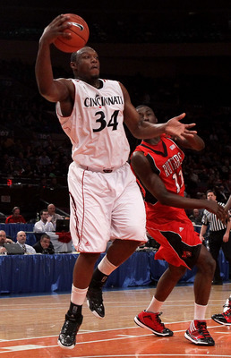 NEW YORK - MARCH 09: Yancy Gates #34 of the Cincinnati Bearcats grabs a loose ball against the Rutgers Scarlet Knights during the first round game of the Big East Basketball Tournament at Madison Square Garden on March 9, 2010 in New York, New York.  (Pho