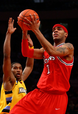 NEW YORK - MARCH 11: D.J. Kennedy #1 of the St. John's Red Storm drives to the hoop against the Marquette Golden Eagles during the second round of the Big East Tournament at Madison Square Garden on March 11, 2009 in New York City.  (Photo by Chris McGrat