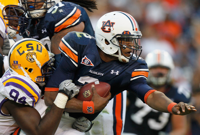 AUBURN, AL - OCTOBER 23:  Quarterback Cameron Newton #2 of the Auburn Tigers is tackled by Kendrick Adams #37 of the LSU Tigers at Jordan-Hare Stadium on October 23, 2010 in Auburn, Alabama.  (Photo by Kevin C. Cox/Getty Images)