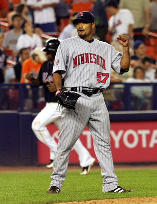 NEW YORK - JUNE 19:  Johan Santana #57 of the Minnesota Twins celebrates his 92 pitch complete game shutout against the New York Mets during their interleague game on June 19, 2007 at Shea Stadium in the Flushing neighborhood of the Queens borough of New