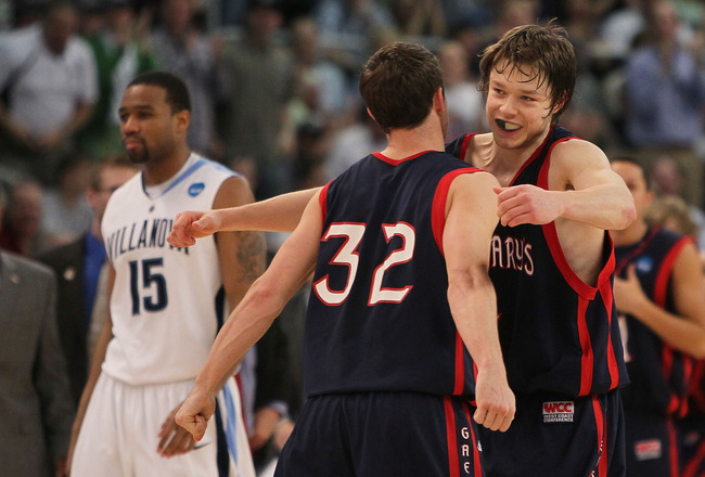 PROVIDENCE, RI - MARCH 20:  Mickey McConnell #32 is hugged by Matthew Dellavedova #4 of the Saint Mary's Gaels after a win as Reggie Redding #15 of the Villanova Wildcats leaves the court during the second round of the 2010 NCAA men's tournament at Dunkin