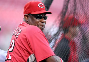 CINCINNATI - OCTOBER 10:  Dusty Baker the Manager of the Cincinnati Reds takes in batting practice before the start of  Game 3 of the NLDS against the Philadelphia Phillies  at Great American Ball Park on October 10, 2010 in Cincinnati, Ohio.  (Photo by A