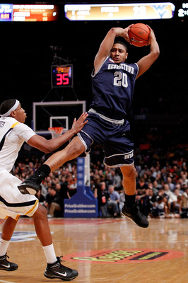 NEW YORK - MARCH 13:  Jerrelle Benimon #20 of the Georgetown Hoyas catches the inbounds pass against Kevin Jones #5 of the West Virginia Mountaineers during the championship of the 2010 NCAA Big East Tournament at Madison Square Garden on March 13, 2010 i