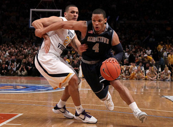 NEW YORK - MARCH 13:  Chris Wright #4 of the Georgetown Hoyas handles the ball against Joe Mazzulla #21 of the West Virginia Mountaineers during the championship of the 2010 NCAA Big East Tournament at Madison Square Garden on March 13, 2010 in New York C