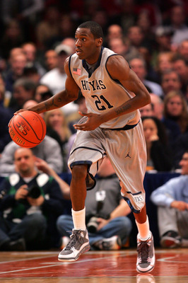 NEW YORK - DECEMBER 08: Jason Clark #21 of the Georgetown Hoyas dribbles the ball against the Butler Bulldogs during the Jimmy V Classic at Madison Square Garden on December 8, 2009 in New York, New York. The Hoyas defeated the Bulldogs 72-65.  (Photo by