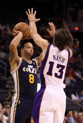 PHOENIX - OCTOBER 12:  Deron Williams #8 of the Utah Jazz looks to pass the ball around Steve Nash #13 of the Phoenix Suns during the preseason NBA game at US Airways Center on October 12, 2010 in Phoenix, Arizona. NOTE TO USER: User expressly acknowledge