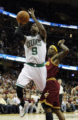 CLEVELAND - OCTOBER 27:  Rajon Rondo #9 of the Boston Celtics looks to get a shot off after getting around Daniel Gibson #1 of the Cleveland Cavaliers at Quicken Loans Arena on October 27, 2010 in Cleveland, Ohio.  (Photo by Gregory Shamus/Getty Images)