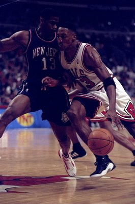 24 Apr 1998: Guard Scottie Pippen of the Chicago Bulls in action against guard Kendall Gill of the New Jersey Nets during a game at the United Center in Chicago, Illinois. The Bulls defeated the Nets 96-93.