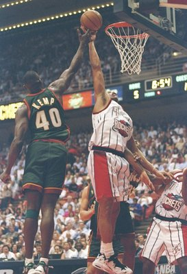 13 May 1997:  Forward Charles Barkley of the Houston Rockets and Shawn Kemp of the Seattle Supersonics jump for the ball during a playoff game at the Summit in Houston, Texas.  The Supersonics won the game 100-94. Mandatory Credit: Stephen Dunn  /Allsport