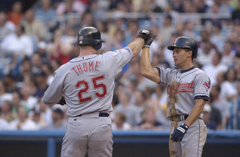 BRONX, NY - JULY 02:  Omar Vizquel #13 congratulates teammate Jim Thome #25 of the Cleveland Indians at home plate against the New York Yankees during the game on July 2, 2002 at Yankee Stadium in the Bronx, New York.  The Yankees won 10-5.  (Photo by Ezr
