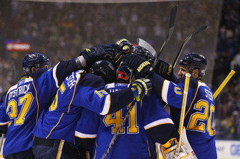 ST. LOUIS - OCTOBER 30: Jaroslav Halak #41 of the St. Louis Blues is congratulated by his teammates after beating the Atlanta Thrashers at the Scottrade Center on October 30, 2010 in St. Louis, Missouri.  The Blues beat the Thrashers 4-3 in a shootout.  (
