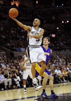 SAN ANTONIO - JANUARY 12:  Guard Tony Parker #9 of the San Antonio Spurs takes a shot against Luke Walton #4 of the Los Angeles Lakers on January 12, 2010 at AT&T Center in San Antonio, Texas.  NOTE TO USER: User expressly acknowledges and agrees that, by