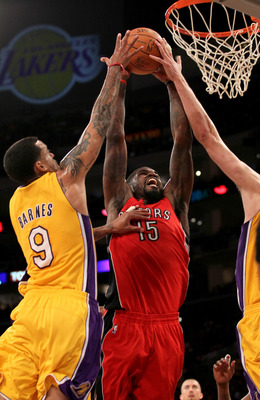 LOS ANGELES - NOVEMBER 5:  Amir Johnson #15 of  the Toronto Raptors goes in for a dunk agqainst Matt Barnes #9 of the Los Angeles Lakers at Staples Center on November 5, 2010 in Los Angeles, California.  The Lakers won 108-102.   NOTE TO USER: User expres