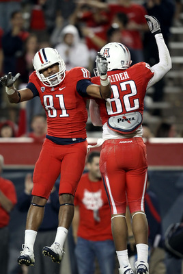 TUCSON, AZ - OCTOBER 23:  Wide receivers David Roberts #81 and Juron Criner #82 of the Arizona Wildcats celebrate after Criner scored a 21 yard touchdown reception against the Washington Huskies during the fourth quarter of the college football game at Ar
