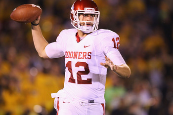 COLUMBIA, MO - OCTOBER 23: Landry Jones #12 of the Oklahoma Sooners in action against the Missouri Tigers at Faurot Field/Memorial Stadium on October 23, 2010 in Columbia, Missouri.  The Tigers beat the Sooners 36-27.  (Photo by Dilip Vishwanat/Getty Imag