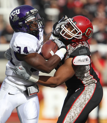 SALT LAKE CITY, UT - NOVEMBER 6: Derrick Shelby #90 of the Utah Utes hits Ed Wesley #34 of the TCU Horned Frogs during the first half of an NCAA football game November 6, 2010 at Rice-Eccles Stadium in Salt Lake City, Utah. (Photo by George Frey/Getty Ima