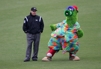 CLEARWATER, FL - MARCH 3:  The Phillie Phanatic jokes with thirdbase umpire Tom Hallion beween innings as the Detroit Tigers defeated the Philadelphia Phillies 9-1 during MLB spring training action at the Bright House Networks Field March 3, 2005 in Clear