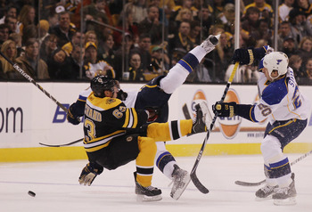 BOSTON - NOVEMBER 06:  Brad Marchand #63 of the Boston Bruins and Alex Pietrangelo #27 of the St. Louis Blues collide as Alexander Steen #20 of the Blues stands by on November 6, 2010 at the TD Garden in Boston, Massachusetts.  (Photo by Elsa/Getty Images