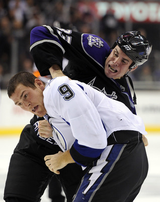 LOS ANGELES, CA - NOVEMBER 04:  Steve Downie #9 of the Tampa Bay Lightning fights with Willie Mitchell #33 of the Los Angeles Kings during the third period at Staples Center on November 4, 2010 in Los Angeles, California. The Kings won 1-0.  (Photo by Har