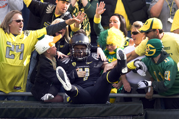 EUGENE, OR - NOVEMBER 06: Wide receiver Josh Huff #4 of the Oregon Ducks jumps into the crowd during the team introductions before the game against the Washington Huskies at Autzen Stadium on November 6, 2010 in Eugene, Oregon. The Ducks won the game 53-1