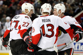 MONTREAL- NOVEMBER 6:  Alexei Kovalev #27 of the Ottawa Senators celebrates his third period goal with teammates Chris Neil #25 and Peter Regin #13 during the NHL game against the Montreal Canadiens at the Bell Centre on November 6, 2010 in Montreal, Queb