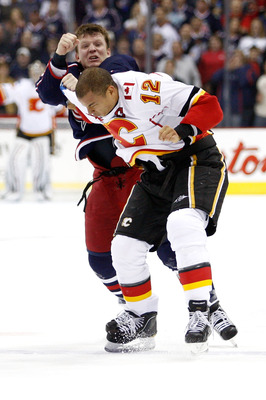 COLUMBUS, OH - OCTOBER 22:  Derek Dorsett #15 of the Columbus Blue Jackets throws a punch while fighting with Jarome Iginla #12 of the Calgary Flames during the first period on October 22, 2010 at Nationwide Arena in Columbus, Ohio.  (Photo by John Griesh