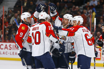 OTTAWA, ON - OCTOBER 28:  Bryan McCabe #24 of the Florida Panthers celebrates his goal against the Ottawa Senators with teammates Stephen Weiss #9, David Booth #10 and Cory Stillman #61 at Scotiabank Place on October 28, 2010 in Ottawa, Ontario, Canada.