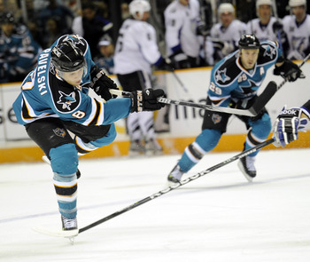 SAN JOSE, CA - NOVEMBER 6:  Joe Pavelski #8 of the San Jose Sharks shoots on goal against the Tampa Bay Lightning during an NHL hockey game at the HP Pavilion on November 6, 2010 in San Jose, California. (Photo by Thearon W. Henderson/Getty Images)
