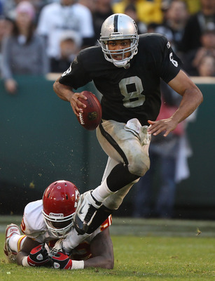 OAKLAND, CA - NOVEMBER 07:  Jason Campbell #8 of the Oakland Raiders runs against Shaun Smith #90 of the Kansas City Chiefs during an NFL game at Oakland-Alameda County Coliseum on November 7, 2010 in Oakland, California.  (Photo by Jed Jacobsohn/Getty Im