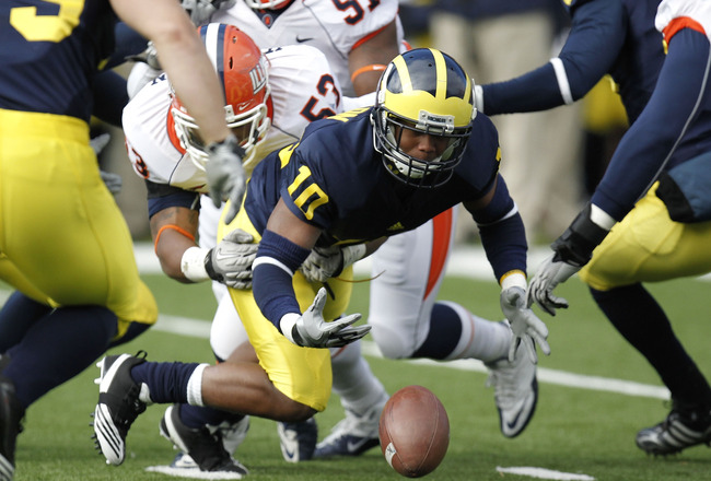ANN ARBOR, MI - NOVEMBER 06:  Jeremy Gallon #10 of the Michigan Wolverines fumbles a kickoff return after being hit by Dustin Jefferson #53 of the Illinios Fighting Illini at Michigan Stadium on November 6, 2010 in Ann Arbor, Michigan. Michigan won the ga