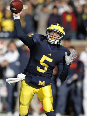 ANN ARBOR, MI - NOVEMBER 06:  Tate Forcier #5 of the Michigan Wolverines throws a fourth quarter pass while playing the Illinios Fighting Illini at Michigan Stadium on November 6, 2010 in Ann Arbor, Michigan. Michigan won the game 67-65. (Photo by Gregory