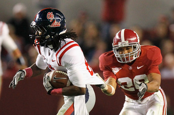 TUSCALOOSA, AL - OCTOBER 16:  DeMarcus Milliner #28 of the Alabama Crimson Tide grabs the jersey of Ja'mes Logan #85 of the Ole Miss Rebels at Bryant-Denny Stadium on October 16, 2010 in Tuscaloosa, Alabama.  (Photo by Kevin C. Cox/Getty Images)