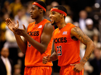 WINSTON-SALEM, NC - JANUARY 21:  Malcolm Delaney #23 and teammate Jeff Allen #0 of the Virginia Tech Hokies celebrate as they run to the bench against the Wake Forest Demon Deacons during their game at Lawrence Joel Coliseum on January 21, 2009 in Winston