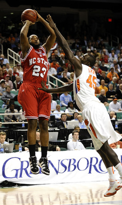 GREENSBORO, NC - MARCH 11:  Jerai Grant #45 of the Clemson Tigers guards Tracy Smith #23 of the North Carolina State Wolfpack in their first-round game in the 2010 ACC Men's Basketball Tournament at the Greensboro Coliseum on March 11, 2010 in Greensboro,