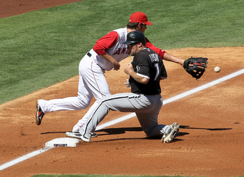 ANAHEIM, CA - SEPTEMBER 26:  Mark Kotsay #7 of the Chicago White Sox slides into third ahead of the throw to third baseman Brandon Wood #3 of the Los Angeles Angels of Anaheim in the second inning on September 26, 2010 at Angel Stadium in Anaheim, Califor