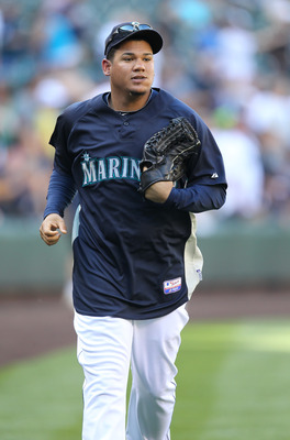 SEATTLE - JULY 08:  Pitcher Felix Hernandez #34 of the Seattle Mariners heads to the dugout during batting practice prior to the game against the New York Yankees at Safeco Field on July 8, 2010 in Seattle, Washington. (Photo by Otto Greule Jr/Getty Image