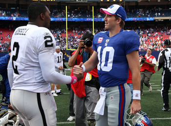 EAST RUTHERFORD, NJ - OCTOBER 11:  Eli Manning #10 of the New York Giants shakes hands with JaMarcus Russell #2 of the Oakland Raiders after their game on October 11, 2009 at Giants Stadium in East Rutherford, New Jersey. The Giants defeated the Raiders 4