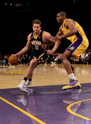 LOS ANGELES - MARCH 2:  Josh McRoberts #32 of the Indiana Pacers drives around Andrew Bynum #16 of the Los Angeles Lakers on March 2, 2010 at Staples Center in Los Angeles, California. The Lakers won 122-99.  NOTE TO USER: User expressly acknowledges and