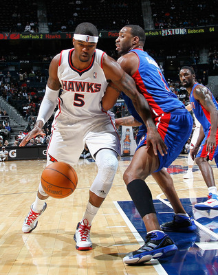 ATLANTA - NOVEMBER 03:  Josh Smith #5 of the Atlanta Hawks drives against Tracy McGrady #1 of the Detroit Pistons at Philips Arena on November 3, 2010 in Atlanta, Georgia.  NOTE TO USER: User expressly acknowledges and agrees that, by downloading and/or u