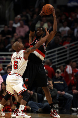 CHICAGO - NOVEMBER 01: LaMarcus Aldridge #12 of the Portland Trail Blazers looks to pass under pressure from Keith Bogans #6 of the Chicago Bulls at the United Center on November 1, 2010 in Chicago, Illinois. The Bulls defeated the Trail Blazers 110-98. N