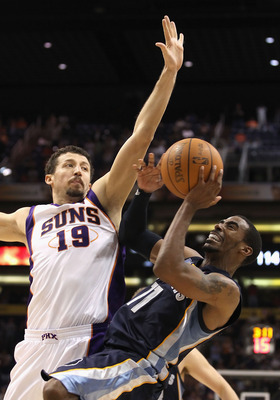 PHOENIX - NOVEMBER 05:  Mike Conley #11 of the Memphis Grizzlies puts up a shot against Hedo Turkoglu #19 of the Phoenix Suns during the NBA game at US Airways Center on November 5, 2010 in Phoenix, Arizona. The Suns defeated the Grizzlies 123-118 in doub
