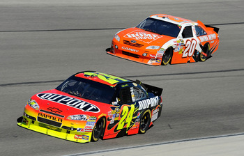 FORT WORTH, TX - NOVEMBER 07:  Jeff Gordon, driver of the #24 DuPont/National Guard Chevrolet, leads Joey Logano, driver of the #20 Home Depot Toyota, during the NASCAR Sprint Cup Series AAA Texas 500 at Texas Motor Speedway on November 7, 2010 in Fort Wo