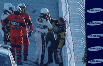 FORT WORTH, TX - NOVEMBER 07:  NASCAR officials break up a fight between Jeff Gordon (2R), driver of the #24 DuPont/National Guard Chevrolet, and Jeff Burton (R), driver of the #31 Caterpillar Chevrolett, as seen on the Sprint Vision screen in the infield