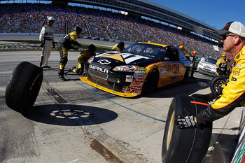 FORT WORTH, TX - NOVEMBER 07:  Jeff Burton, driver of the #31 Caterpillar Chevrolett, makes a pit stop during the NASCAR Sprint Cup Series AAA Texas 500 at Texas Motor Speedway on November 7, 2010 in Fort Worth, Texas.  (Photo by Todd Warshaw/Getty Images